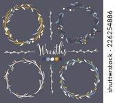 Four vector floral wreaths. Hand drawn design elements set.