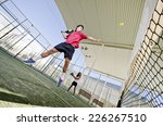 paddle tennis couple playing in ... | Shutterstock . vector #226267510