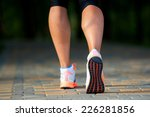 a woman with an athletic pair... | Shutterstock . vector #226281856