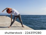 performing joga on windy day.... | Shutterstock . vector #226359280