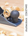 Small Block Plane and Wood on work bench with shavings - stock photo
