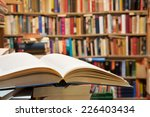old open book with library... | Shutterstock . vector #226403434
