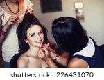 young beautiful girl applying... | Shutterstock . vector #226431070