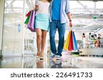 Legs Of Young Couple Shopping...