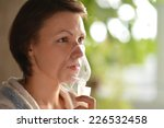 a cold woman with inhaler in... | Shutterstock . vector #226532458