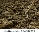 shovel in the ploughed ground   Shutterstock . vector #226537999