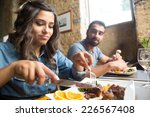 couple having lunch at rustic... | Shutterstock . vector #226567408