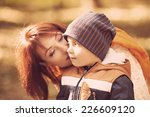 mother and son playing on... | Shutterstock . vector #226609120