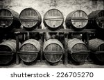 barrels stacked in the winery...   Shutterstock . vector #226705270