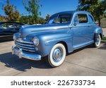 Постер, плакат: A blue 1948 Ford