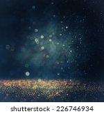 Stock photo glitter vintage lights background gold silver blue and black de focused 226746934