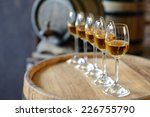 glasses of wine in cellar with...   Shutterstock . vector #226755790