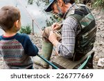 Man And His Grandson Fishing