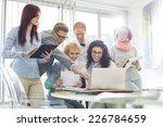 smiling creative businesspeople ... | Shutterstock . vector #226784659