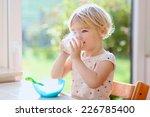 happy little child  blonde... | Shutterstock . vector #226785400
