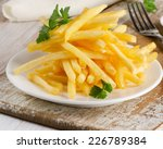 French Fries On  Wooden Board....