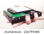hand with hard drives | Shutterstock . vector #226795480