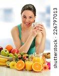 young woman having breakfast.... | Shutterstock . vector #226797013