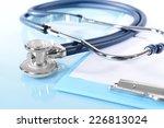 stethoscope on light blue... | Shutterstock . vector #226813024