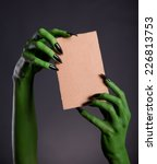 green monster hands holding... | Shutterstock . vector #226813753