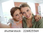 cheerful girlfriends taking... | Shutterstock . vector #226825564
