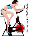 young woman in a spinning class | Shutterstock .eps vector #226832464