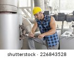 young manual worker using... | Shutterstock . vector #226843528
