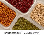 Постер, плакат: Beans selection in plastic