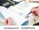 businessman analyzing a...   Shutterstock . vector #226887634
