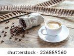 cup of coffee with coffee beans | Shutterstock . vector #226889560