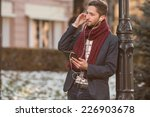man with tablet on the street | Shutterstock . vector #226903678