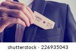 businessman removing a wooden... | Shutterstock . vector #226935043