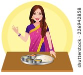 indian woman with indian food... | Shutterstock .eps vector #226942858