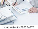 businessman analyzing... | Shutterstock . vector #226954270