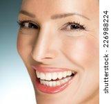 beautiful woman smiling   close ...   Shutterstock . vector #226988224