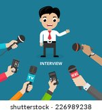 media conducting a press... | Shutterstock .eps vector #226989238