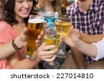 young friends having a drink... | Shutterstock . vector #227014810