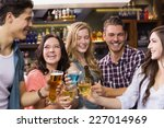 young friends having a drink... | Shutterstock . vector #227014969