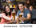 young couple having a drink...   Shutterstock . vector #227015788