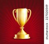 golden trophy cup on red... | Shutterstock . vector #227020549