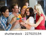 young friends having a drink... | Shutterstock . vector #227025154