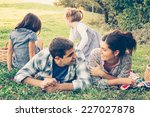 happy family of four lying in... | Shutterstock . vector #227027878