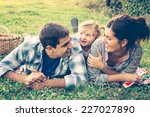 happy family of three lying in... | Shutterstock . vector #227027890