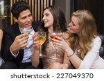 happy friends having a drink...   Shutterstock . vector #227049370