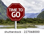 time to go written on red road... | Shutterstock . vector #227068000