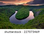 Sunset Over A River Meander In...