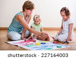 mother and siblings painting... | Shutterstock . vector #227164003
