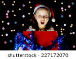 a pretty little girl opens her... | Shutterstock . vector #227172070