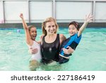 cute swimming class in pool... | Shutterstock . vector #227186419