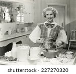 domestic goddess baking in the... | Shutterstock . vector #227270320